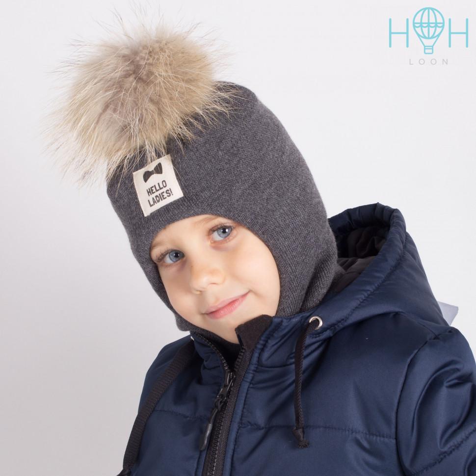 """ШЗ20-06221747 Зимняя шапка-шлем с натуральным помпоном из енота и нашивкой """"Hello ladies"""", темно-серый"""
